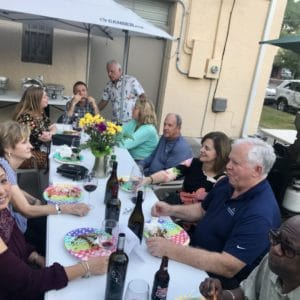 guests enjoying food and wine together outback of Ellen's Wine Room