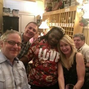 guests posing inside of Ellen's Wine Room
