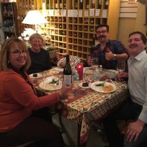 Ellen sharing dinner and wine with friends inside of Ellen's Wine Room