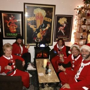 guests at Ellen's Wine Room dressed in Santa costumes for holidays