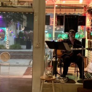 live musician playing acoustic guitar at Ellen's Wine Room
