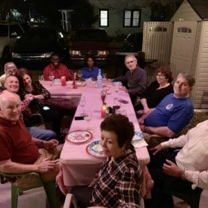 guests enjoying food and wine out back of Ellen's Wine Room at night