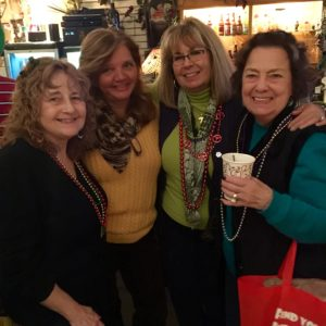 Ellen and friends smiling inside of Ellen's Wine Room