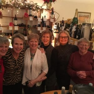 smiling ladies posing inside of Ellen's Wine Room