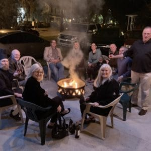 guests around fire pit enjoying wine from Ellen's Wine Room at night