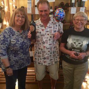 Man celebrating birthday at Ellen's Wine Room posing with Ellen