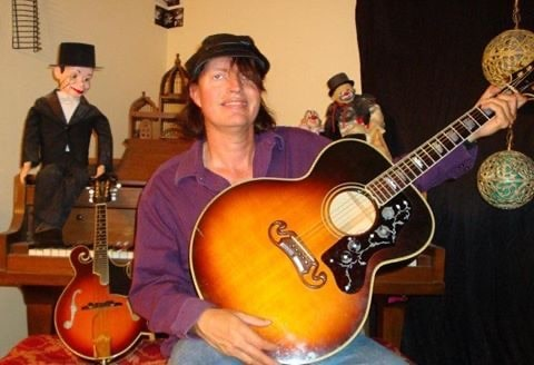 Chuck Culberston playing guitar